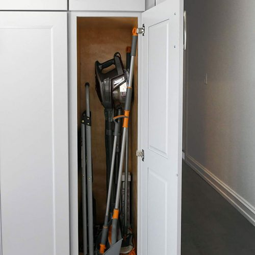 Tall utility cabinet to hide cleaning instruments